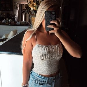 Beige and white floral scrunch top crop tank